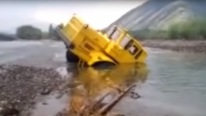Tractor Driver Refuses to Give up After His Vehicle Gets Stuck In a River