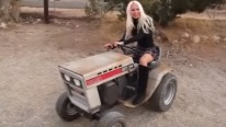 Woman In a Man's World! Blonde Girl Driving Old Garden Tractor