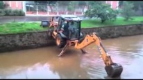 Backhoe-Loader Descends Into Water Like a Boss