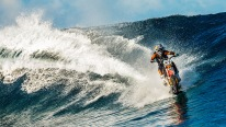 Mind-blowing video of a man surfing a huge wave on a dirt bike