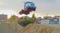 Stunt Family Break Two World Records! 166ft Truck Jumping