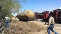HUGE HAUL TRAILER Loaded With Large Gas Tank ROLLS OVER!