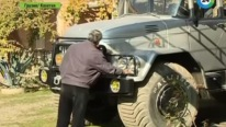 "Georgian Pensioner with His Five-Ton Jeep ""Chacho"""