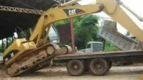 Caterpillar 320C L Hydraulic Excavator Tries to Get On 10 Wheel Truck