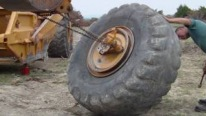 This Is How to Remove a Huge Tire Off a Scraper