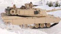 United States Army Forces: M1A1 Battle Tank Drifts in Snow