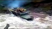 Russian Trucks Cross the River with a Huge Timber Load