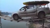 Insane Footage: Pickup Truck Goes Across a Super Thin Wooden Bridge with a Boat Behind
