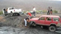 That's Certainly Not the Best Way of Pulling a Truck Out of the Mud!