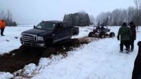 Surprisingly Powerful Buggy Pulls out Mega Truck from Snow Bog