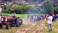 Coolest Tug of War Ever: 1 Tractor Vs. 30 Men