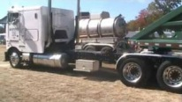 Smokin' Hot 1987 Peterbilt Cabover Cruises Down the Road