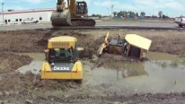 Caterpillar 345C L Hydraulic Excavator Caught on Camera While Rescuing 2 Stuck John Deere Dozers from Canal