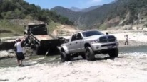 CUMMINS POWER - 6.7L Cummins Powered Pickup Pulls Out another Truck Stuck in the Mud