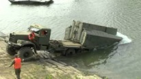 "This Badass Off-road Truck ""KrAz-255"" Launches a Fantastic Portative Bridge On The Water. MUST See!"