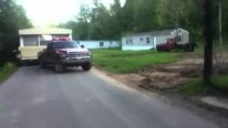 Cummins Powered Dodge Pickup Truck Pulls a Single-Wide Mobile Home