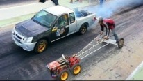 Extraordinarily Enjoyable Battle: Turbocharged V8 Powered Mitsubishi Pickup Truck Vs 5hp Lawnmower