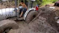 Bizarre Rescue Footage: Huge Tractor Got Stuck in the Mud So Badly