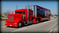 And It's Red: Perfectly Red 1999 Kenworth W900 Big Rig Cruises Down the Road Like a Legend