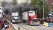 Drag Racing Between Two Semi Trucks of the Same Brand, Engine and Age