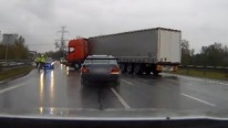 Who Needs a Complex Road Block When You Have Some Courageous Semi-trucks Drivers! Police Chase BMW Driver