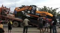 Loading a Huge Excavator in the Middle of a Busy Road in East Timor