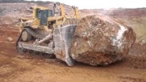 Insane Bulldozer Caterpillar D11R Pushes a Gigantic Rock With Its Breathtaking Power