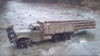 An Extreme Mission on the Land of Extremities: Overloaded Russian Army Truck Tries to Cross a Fierce River
