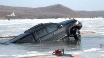 This is How It's Done: Brilliant Guys Pull Huge Vehicle Out of Ice-Cold Water in Less Than 10 Minutes