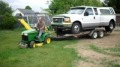 John Deere GT225 Lawn Tractor Pulls the Huge Ford F350 Truck and the Trailer