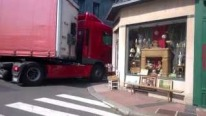 Brave French Truck Driver Tries To Drive Through a Narrow Street