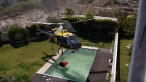 Skillful Helicopter Pilot Taking Water From Swimming Pool